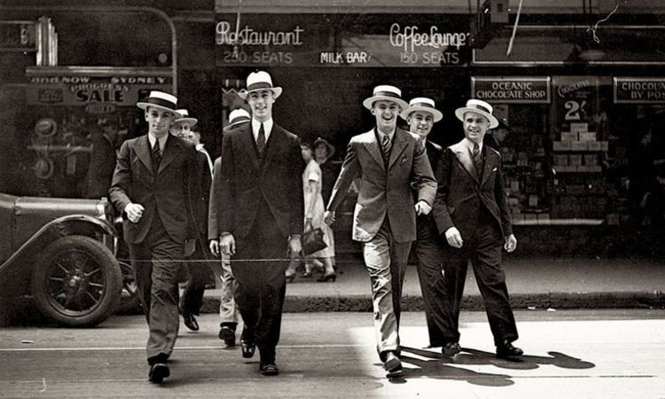 Men model hats in Pitt Street for city hatters 1 november 1934 by Ernie Bowen